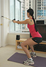 Lady doing resistance bands workout
